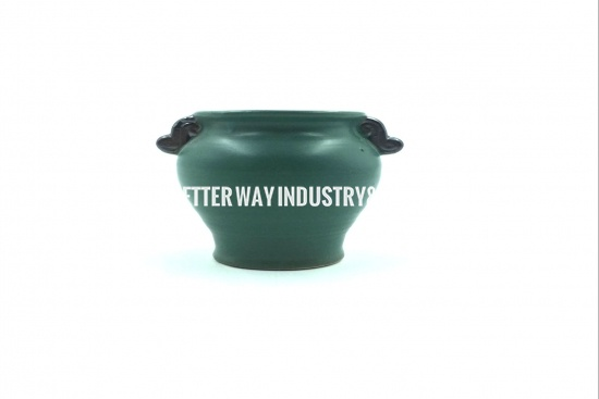 green terracotta plant pots